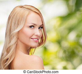 face and shouldes of happy woman with long hair - health and...