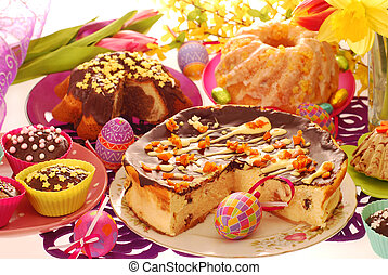 easter confectionery on festive table - assortment of easter...