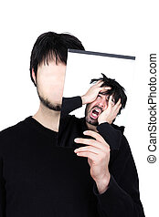 two faces despair - symbolic image of a man holding his face...