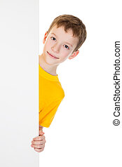 Boy peek out from vertical white banner - Smiling boy peek...