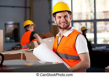 sonriente, fábrica, trabajador