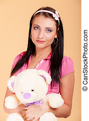 Childish young woman infantile girl in pink hugging teddy...