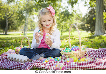 Cute Young Girl Coloring Her Easter Eggs with Paint Brush -...