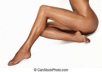 Long legs. - Long beautiful female legs tanned.