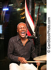 Smiling musician - Smiling african musician at an alive...