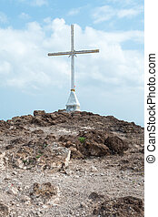 Christian Cross on Hill 3 - Cross on Rugged Summit with Blue...