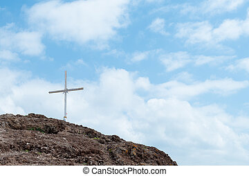 Christian Cross on Hill 1 - Cross on Rugged Summit with Blue...