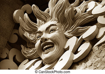 Bas-relief of the sun on a wall. Bali. Indonesia
