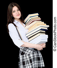 Girl with a pile of books in hands on black