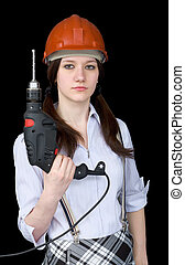 Beautiful girl in a protective helmet with a drill