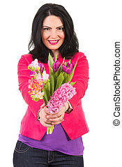 Happy woman giving spring flowers