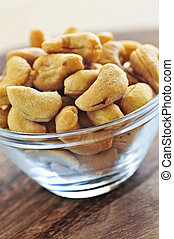 Cashew nuts in glass bowl - Close up of cashew nuts in glass...