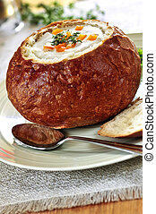 Soup in bread bowl - Lunch of soup served in baked round...