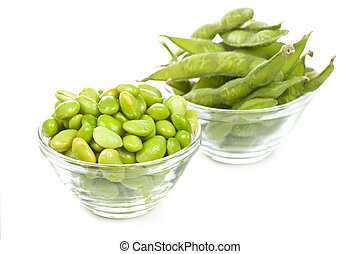 Soy beans - Edamame soy beans shelled and with pods in bowls