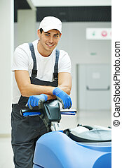 male worker cleaning business hall - Cleaner male man...