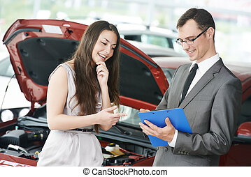 Car selling or auto buying - Car salesperson demonstrating...