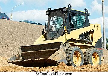 skid steer loader at earth moving works - skid steer loader...