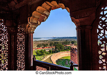 Ornamented window and the Taj - The impressive Red Fort in...