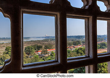 Viewing Taj Mahal trough a window - The impressive Red Fort...