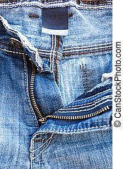 zip on jeans - zip on blue jeans with very shallow focus
