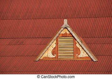 Dormer window in red corrugated iro