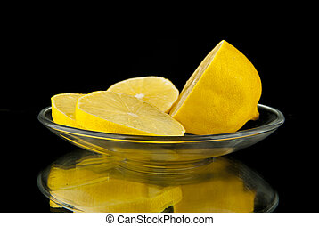 lemon is cut in a glass saucer