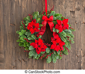 Advent wreath with winter rose as decoration