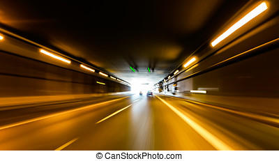 Tunnel - A car going full speed at the end of the tunnel