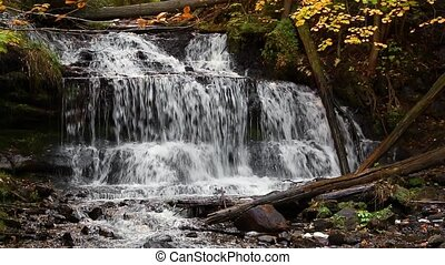 Wagner Falls Autumn Loop - Whitewater flows over Wagner...