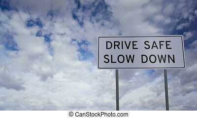 Sign Drive Safe Slow Down Clouds Ti - Timelapse clouds...