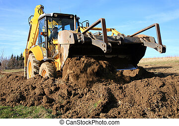 construction of a new road - Bulldozer, excavator pushes the...