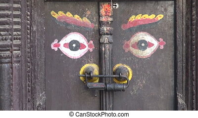ornamental ancient door with Buddha eyes in Katmandu old...