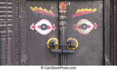 ornamental ancient door with Buddha eyes in Katmandu old...