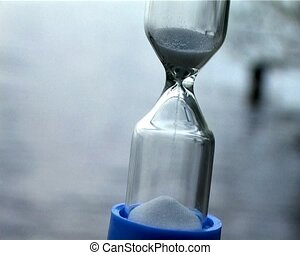 sand clock - small glass sand clock with flowing water as...