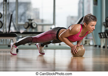 Push-Ups On Medicine Ball - Attractive Female Athlete...