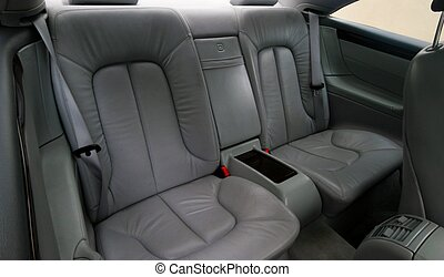 Rear gray leather vehicle seats - A close-up photo of Rear...