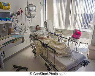 Patient asleep in hospital bed - Person recuperation from...
