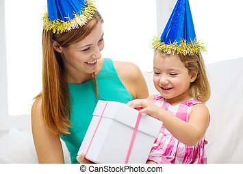 mother and daughter in blue hats with gift box