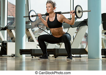 Woman Doing Squats - Beautiful Fit Woman Doing Barbell...
