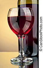 bottle and a glass of wine