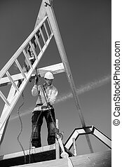 Builder with ladder and winch