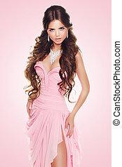 Beautiful brunette woman wearing in sexy luxury dress over...