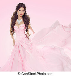 Beautiful brunette girl wearing in wedding dress isolated on...