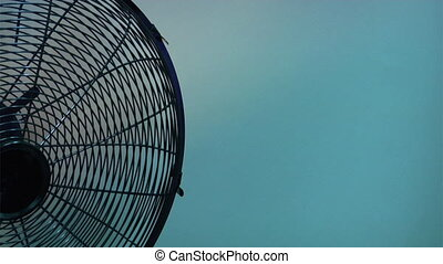 electric fan as background - the close-up view half of...
