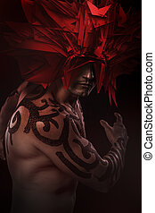 Warrior covered with tribal, strange red mask
