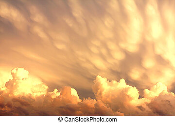 Mammatus and Cumulus Clouds After a Storm - rare formation...