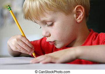 Young Child Drawing with Paper and Pencil - a cute young...