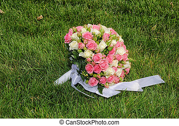 Wedding bouquet from roses in a grass