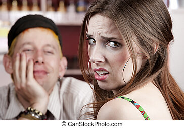 Bad Date - Young woman making an exasperated expression...