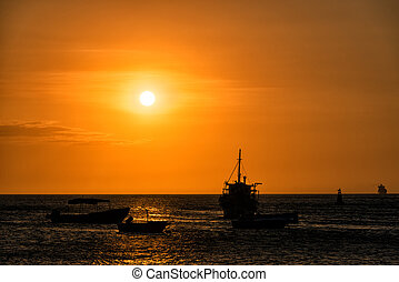 Boats at Sunset - Silhouettes of boats at sunset off of the...